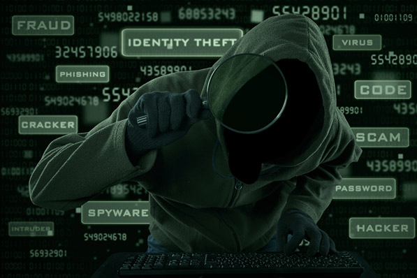 The figure shows a figure in a hoodie using a magnifying glass
